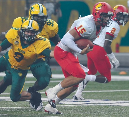 Challenging the Champs: Ferris sophomore quarterback Jason Vander Laan eludes a North Dakota State tackle during Saturday's game. Ferris lost to FCS Champion North Dakota State 56-10 and is now preparing to face Lake Erie Collegef or the start of Great Lakes Intercollegiate Athletic Conference play. Courtesy Photo By: Dennis Hubbard