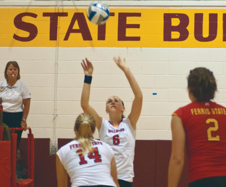 Setting up Victory: Ferris freshman setter Stephanie Sikorski sets up a spike for sophomore outside hitter Caroline Heitzman during the Bulldog Invitational, where they went 3-1 overall. This weekend the women's volleyball team will take on both Northwood and Hillsdale. Torch File Photo