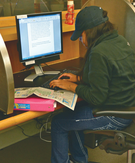 Social work major Michele Loney works on her homework and receives tutoring as part of OMSS and the Ferris Honors program's extended tutoring hours. The extended tutoring is from 5 to 10 p.m. in FLITE 159 and will run until Nov. 30.  Photo By: Olivia Odette | Photographer