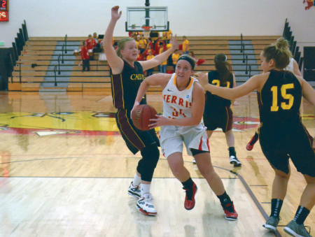 Ashley Rando breaks through Calvin defense during the 2012-13 basketball season. This year the girls are facing a gap in the season and won't play until Nov. 23 when they face Nova Southeastern in the United Electric Tip-off Classic. Torch File Photo