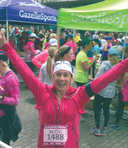 Professor Betsy Verwys celebrates after completing the Gazelle Girl Marathon in Grand Rapids, raising money for SowHope with every mile she ran.  Photo Provided By: Betsy Verwys